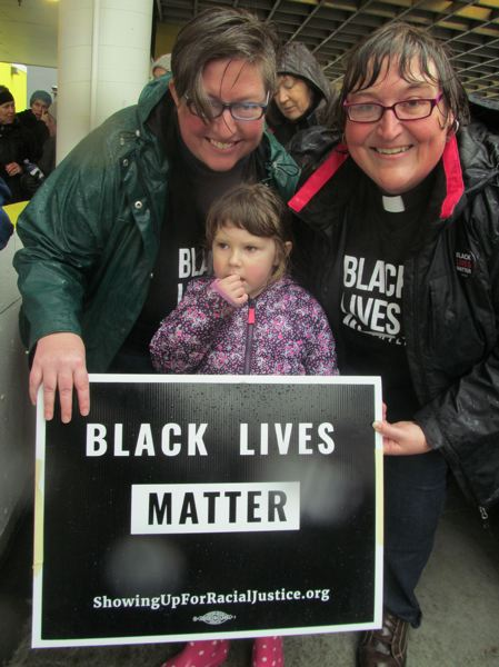 PHOTO BY ELLEN SPITALERI - Sadie and Rev. Elizabeth Durant brought their 4-year-old daughter Ellie to the march on Saturday; Ellie has attended protest marches with them before, they noted.