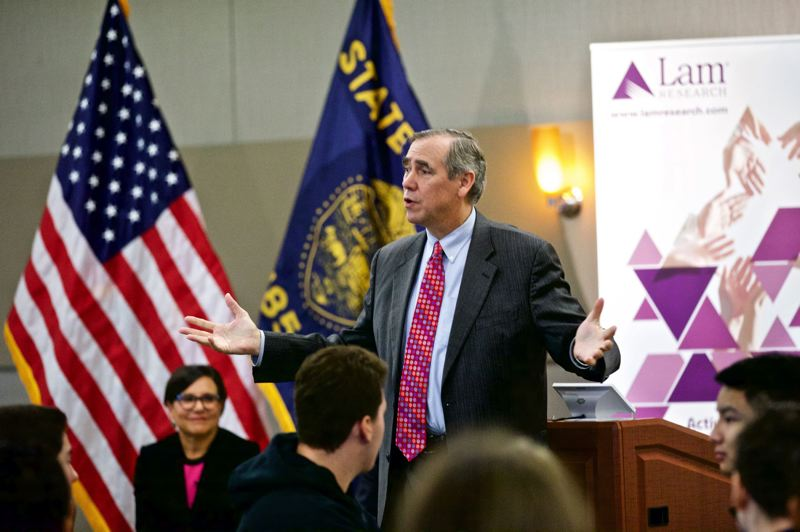 FILE - U.S. Sen. Jeff Merkley talks to high school students at Lam Research in Tualatin in the fall.