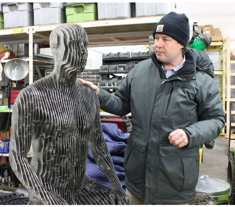 """TRIBUNE PHOTO: LYNDSEY HEWITT - Many of Julian Voss-Andreae's distinctive sculptures are made of thin stainless steel plates. He says: """"In my world view, you take for granted that this stuff is actually there and solid. Both are not true in quantum physics. ...'"""