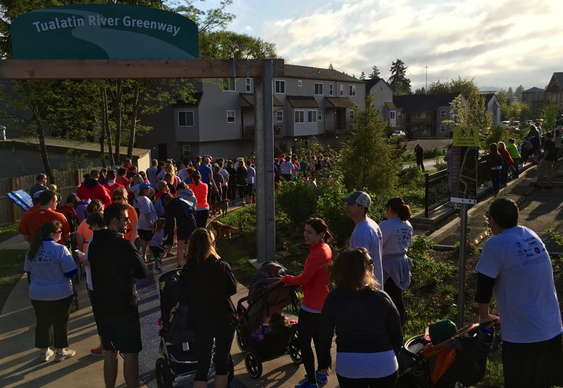 FILE - People set out on a 5K run/walk on the new segment of the Tualatin River Greenway Trail last April. Tualatin is vying to be named, along with partner Tigard, as a Blue Zones demonstration community to receive training and funding intended to improve public health and longevity.