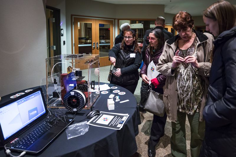 TIMES PHOTO: JONATHAN HOUSE - Tualatin State of the City attendees check out a 3D printer at the Makerspace demonstration.