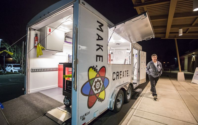 TIMES PHOTO: JONATHAN HOUSE - John Bartholomew of the Tualatin America's Best Communities team stands alongside the new Mobile Makerspace trailer, which made its public debut at Living Savior Lutheran Church on Tuesday.