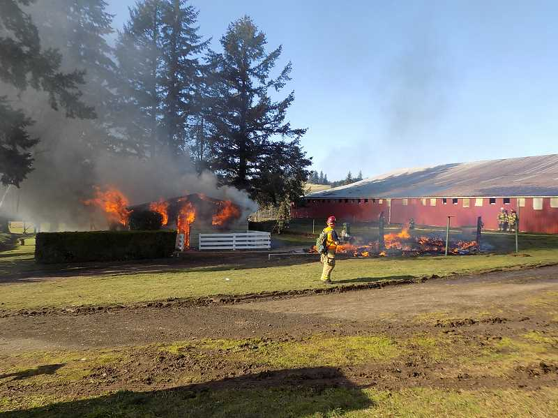 GAZETTE PHOTO: RAY PITZ  - After the garage burned down, left, the adjacent home was set ablaze as well and came down relatively quickly on Jan. 27.