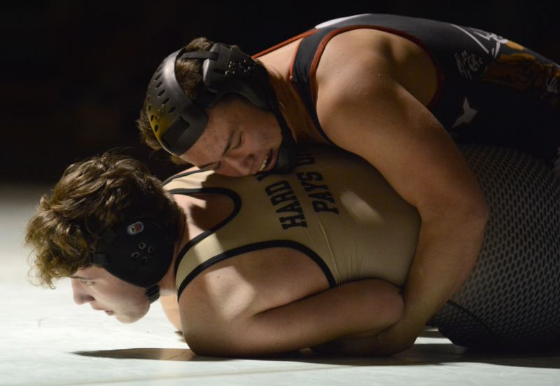 Wrestlers turn back a challenge from Mustangs