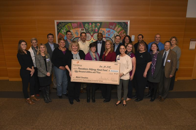 PHOTO COURTESY: PROVIDENCE - Providence Federal Credit Union and Helping Hands Fund supporters gather for the check presentation.