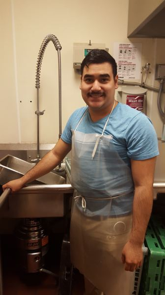 PHOTO COURTESY: LESLIE ROBINETTE - Gladstone alum Daniel Diaz Rodrigues won a state award for students with disabilities. He now is employed in the kitchen at John Wetten Elementary School.