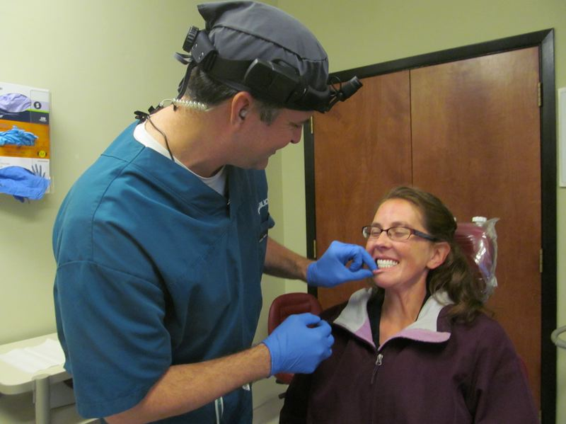 PHOTO BY ELLEN SPITALERI - Dr. Russell Lieblick said Christina Mercier's new smile is awesome and heartwarming, while Mercier describes the dental procedure as amazing.
