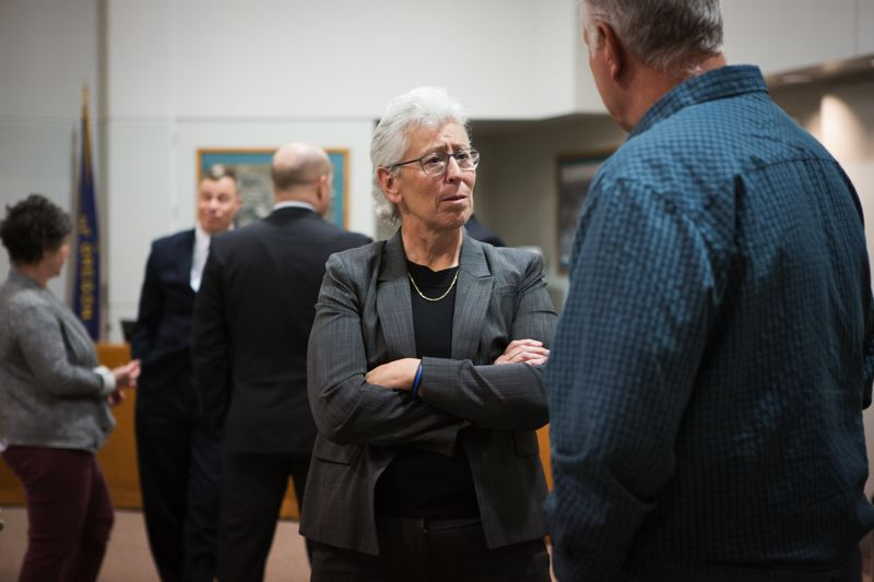 TIMES PHOTO: ADAM WICKHAM - Tigard police chief candidate Kathy McAlpine, who is currently assistant chief of police in Tacoma, Wash., converses with a member of the public during a community meeting at Tigard City Hall.