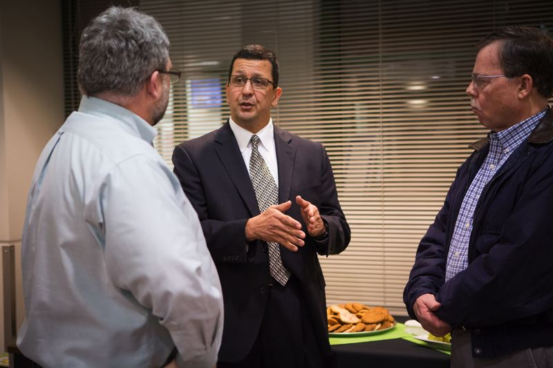 TIMES PHOTO: ADAM WICKHAM - Police Chief George Delgado of Des Moines, Wash., in the running to be named as Tigard's next police chief, talks with Tigard City Council President Jason Snider and resident Neal Brown.