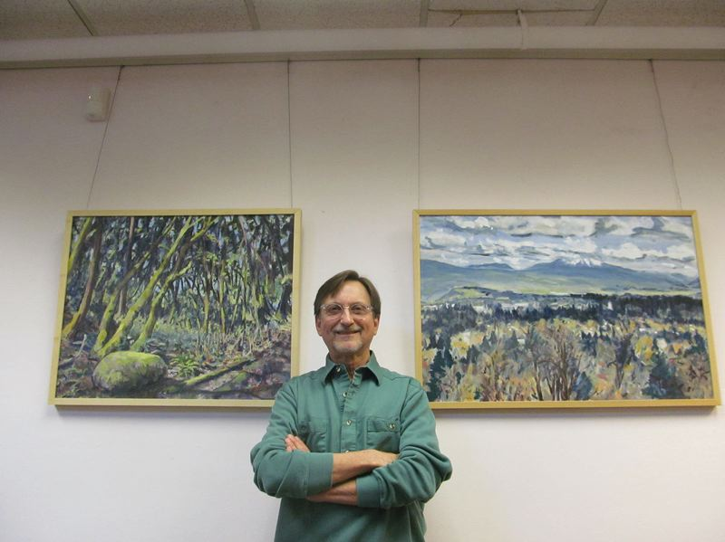 PHOTO BY ELLEN SPITALERI - Artist David Mayfield chose specific local landscapes to appeal to residents who come into Milwaukie City Hall to see his current exhibit there. Left is a painting featuring mossy rocks and tree trunks, and right is a view of Mt. Hood on a cloudy day.