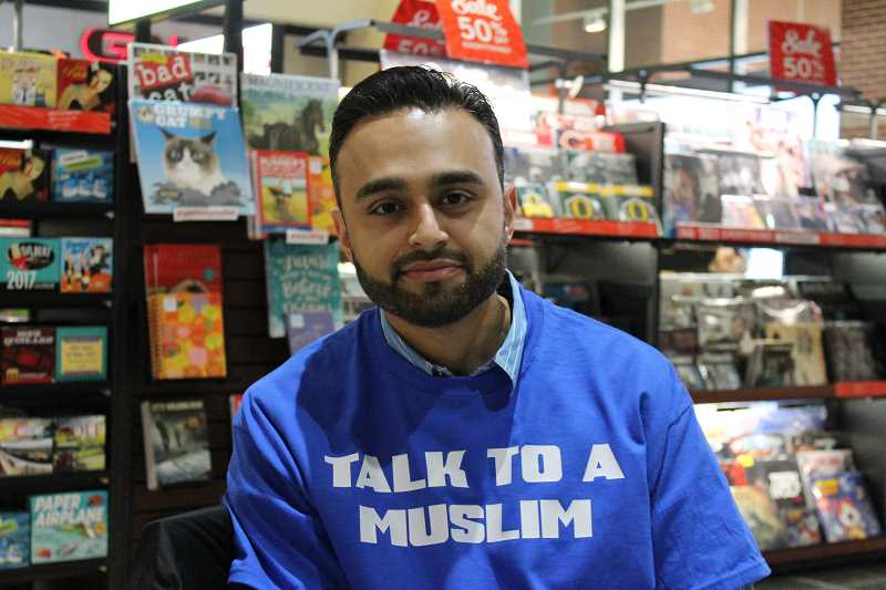 CONNECTION PHOTO: HANNAH RANK - Harris Zafar wears a 'Talk to a Muslim' shirt at one of his outreach events at Washington Square.