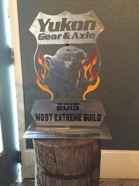 COURTESY PHOTO: STU LUXENBERG - The Yukon sign is a trophy for an off road truck-building contest in Florida. This is a small version of the logo for Yukon Gear & Axel, which is one of the event sponsors. The flames were added by Luxenberg because ...well, flames are cool.