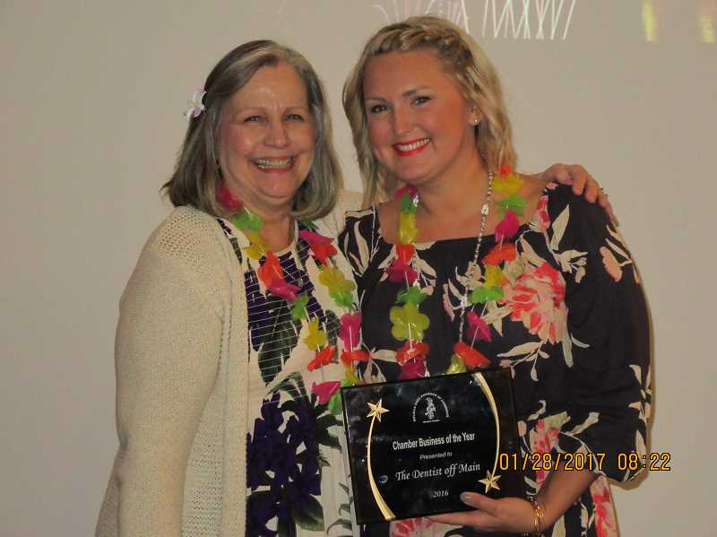 PIONEER PHOTO: GEORGIA NEWTON  - Chamber President Connie Farrens (left)presents Business of the Year Award to Dr. Olesya Salathe.