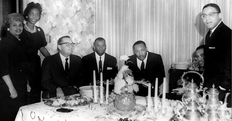COURTESY PHOTO - The Rev. Dr. Martin Luther King Jr., center, met with clergy and members of Portland's Vancouver Avenue First Baptist Church during a 1961 visit to the Northwest. The church was a center for the region's Civil Rights movement.
