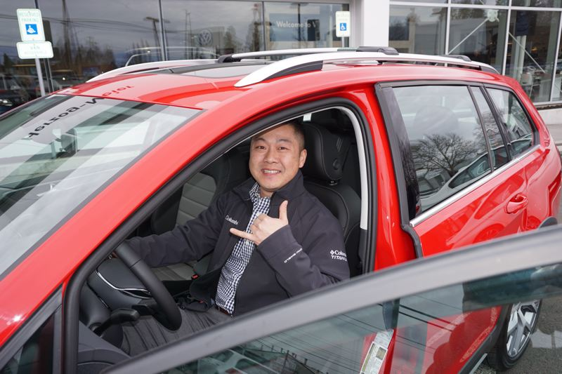 PAMPLIN MEDIA GROUP: JEFF ZURSCHMEIDE - Henry Cha was the lucky winner of the 2017 Volkswagen Golf Alltrack SEL, given away by the Metro Portland New Car Dealers Association and Pamplin Media Group at the Portland International Auto Show. Cha and three other finalists were chosen at random from those who entered the drawing at the show. Each finalist selected an identical key and Cha's opened the car, winning the contest.