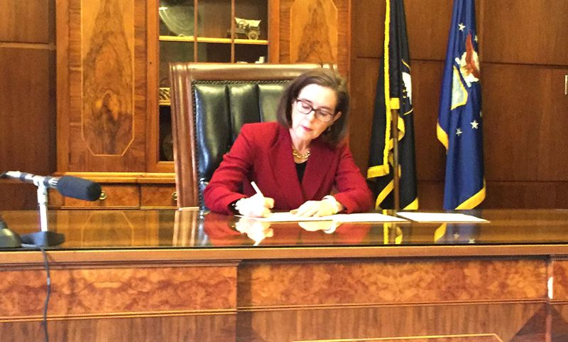 TRIBUNE PHOTO: PARIS ACHEN - Gov. Kate Brown signed an executive order Thursday, Feb. 2, emphasizing the state's opposition to President Trump's immigration restrictions.