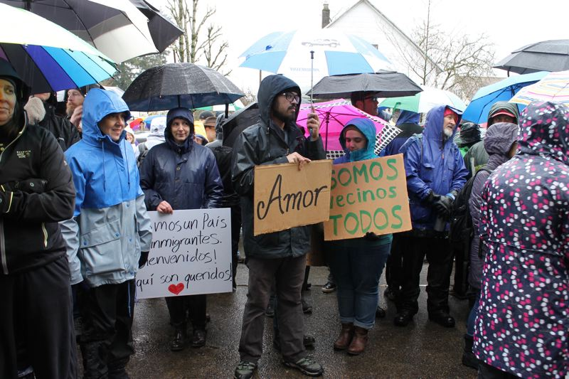 TRIBUNE PHOTO: LYNDSEY HEWITT - A crowd of 200 or more gathered around St. Peter Catholic Church, 5905 S.E. 87th Ave., on Sunday, Feb. 5, in response to a racist incident that occurred a week ago when a group of men stopped at the church and shouted racist slurs at those going in for the Spanish mass.