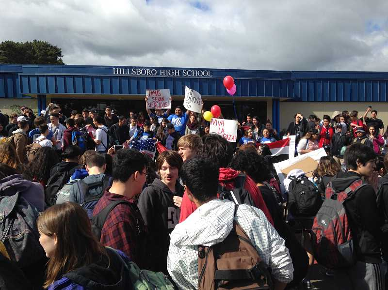 TRIBUNE FILE PHOTO - Students march out of Hillsboro High School last spring after racially insensitive remarks were posted on a wall at Forest Grove High. The Hillsboro School District is working on guildelines for staff should immigration officials begin asking for information from district schools.
