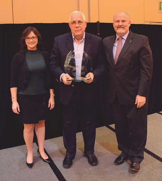 COURTESY PHOTO: OREGON FARM BUREAU - Doug Hoffman (middle), CEO of Wilco, was presented with the Oregon Farm Bureau President's Award at the 84th OFB Annual Meeting in Salem by (left) OFB First Vice President Peggy Browne and OFB Executive Vice President Dave Dillon.