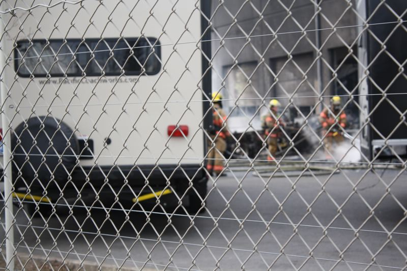 OUTLOOK PHOTO - Firefighters douse parts of a damaged RV after a fire at Camping World in Wood Village on Thursday, Feb. 2.