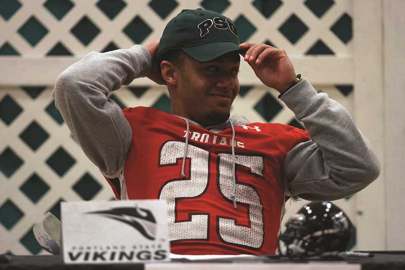 PHIL HAWKINS - Kennedy High School senior running back Bishop Mitchell signed his letter of intent on Feb. 1 to play for the Portland State Vikings football team next season.
