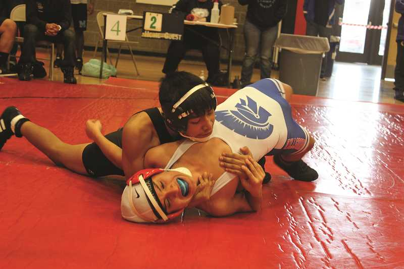 WOODBURN WRESTLING TEAM - Woodburn freshman Wesley Vasquez (top) went 4-0 to claim the 106-pound championship on Saturday at the Bill Geister Invitational hosted at Clackamas High School.