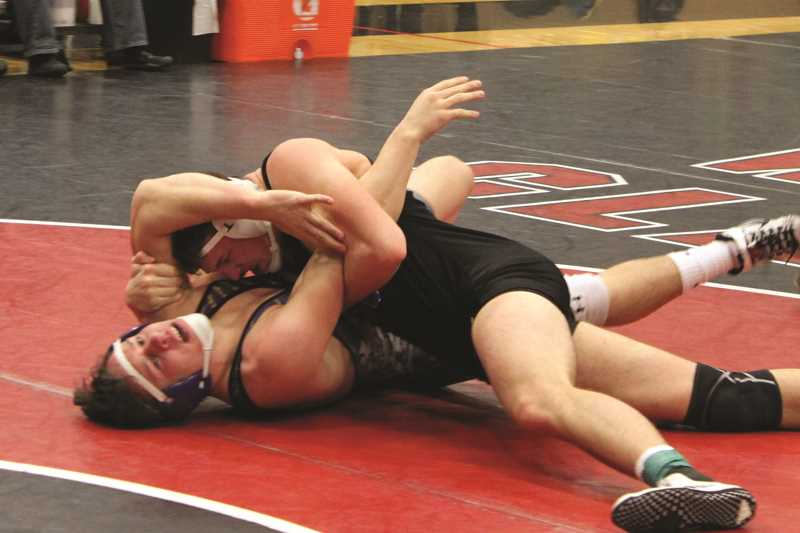 WOODBURN WRESTLING TEAM - Woodburn senior Karson Christiansen scored a dramatic first round victory in the 170-pound championship match over Sunset's Garrett Lewis at the Bill Geister Invitational in Clackamas on Saturday.