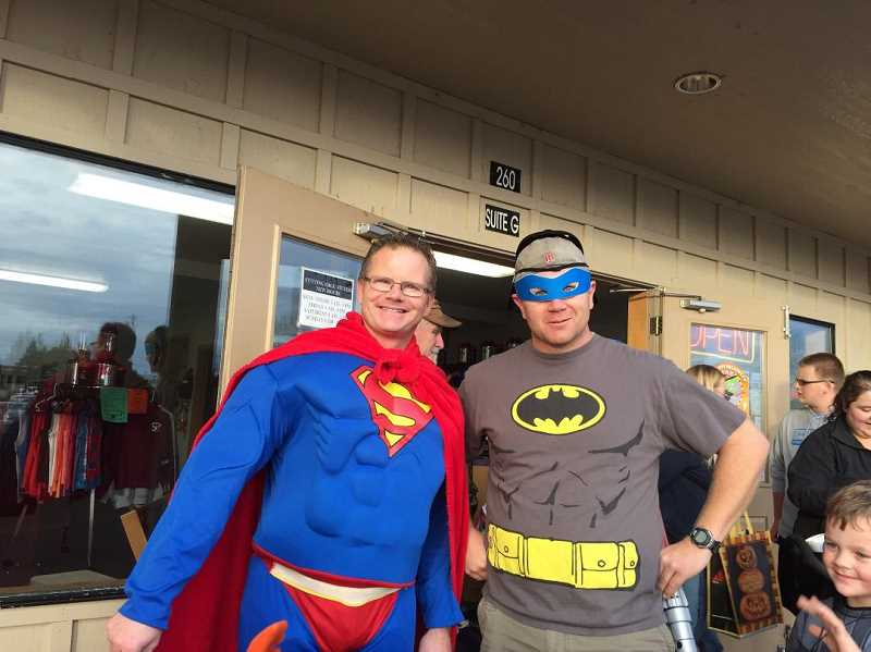 SUBMITTED PHOTO: SHELDON SANDERS  - Sheldon Sanders, left, with Jason Ritter, in costume for Halloween 2016 outside Cutting Edge Fitness.