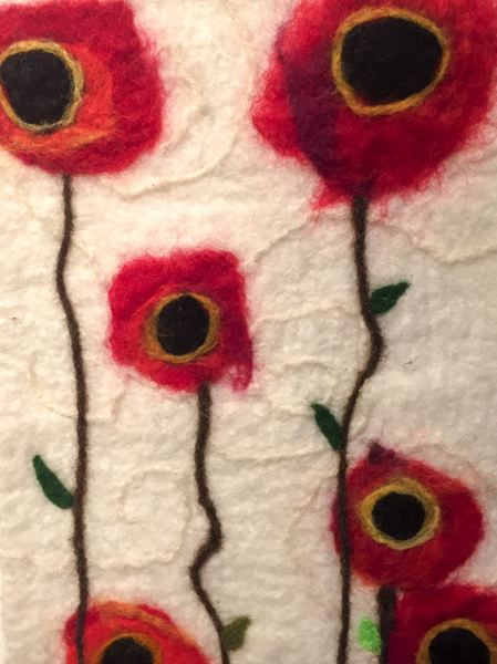 ESTACADA NEWS PHOTO: EMILY LINDSTRAND - Am Griswold said her felted wool piece Poppies was a departure from her usual work but found the finished product satisfying.