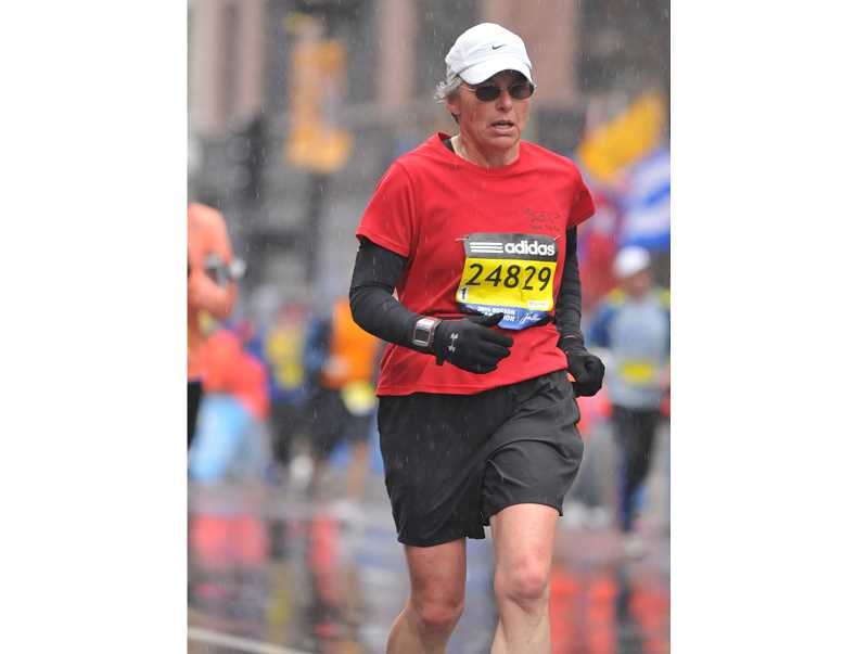 SUBMITTED PHOTO - Nancy Richards,of Madras, runs the Boston Marathon in 2015, and crosses the finish line in the throes of a heart attack. Since then, Richards has been working with a cardiologist to regain her health. On Feb. 12, she plans to run a half-marathon, in Hillsboro.