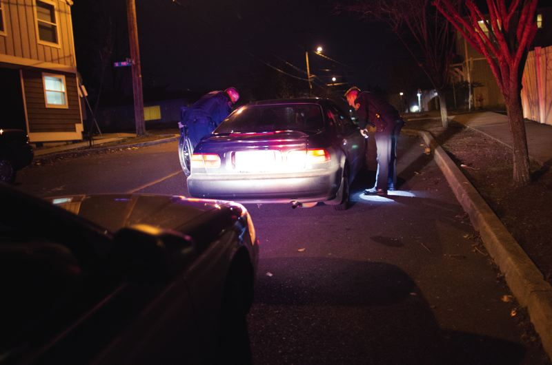 TRIBUNE PHOTO: JAIME VALDEZ - Portland police stop a motorist in the central city. Portland is one of the few cities In Oregon that requires  traffic and patrol officers to record so-called stop data.