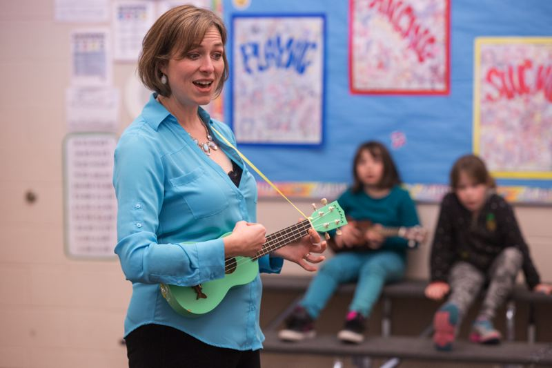 TIMES PHOTO: JONATHAN HOUSE - Alberta Rider Elementary School music teacher Emily Kelchner Lee leads her class in a few ukulele arrangements.