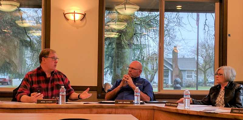 SPOTLIGHT PHOTO: COURTNEY VAUGHN - Port of St. Helens Commissioners Mike Avent, Larry Ericksen and Paulette Lichatowich discuss matters during a board of commissioners meeting Wednesday, Feb. 8. Commissioners voted Wednesday to hire a new executive director.