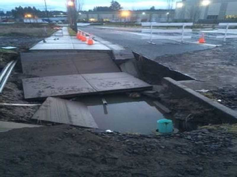 COURTESY OF CITY OF SHERWOOD - Here's what a stretch of sidewalk looks like on Century Drive after being destroyed by a cascade of water Feb. 5 and 6.
