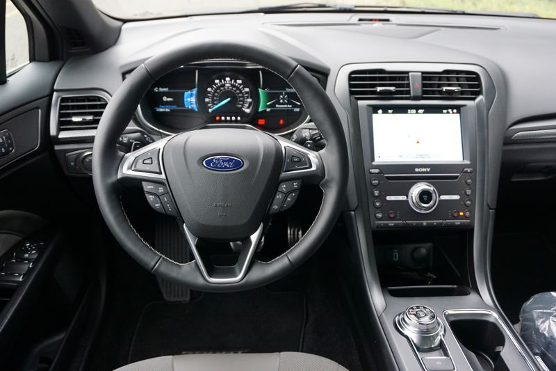 PORTLAND TRIBUNE: JEFF ZURSCHMEIDE - Inside, the 2017 Fusion Sport offers a comfortable luxury interior, with a dial-based gear selector on the console, similar to the design you'll find in a Jaguar. You also get heated suede and leather seats and a nice big touch screen infotainment interface with optional GPS navigation.