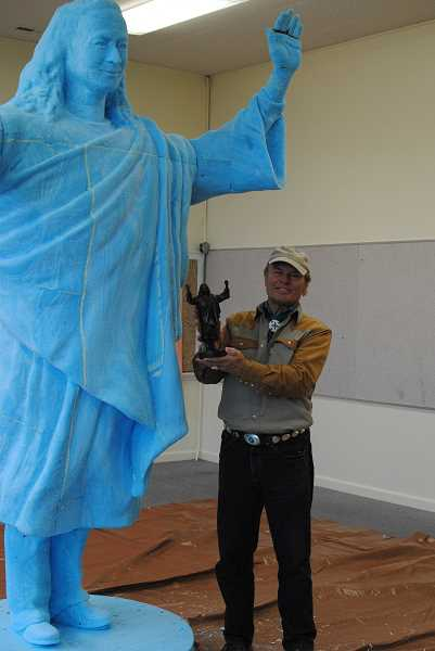 NEWS-TIMES PHOTO: STEPHANIE HAUGEN - Artist Gary Roller visited Laurelwood recently to work on the large statue of Yogananda that will go into a public space on the center's grounds.