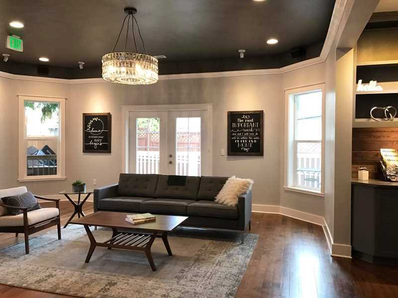 COURTESY OF GARDNER REAL ESTATE TEAM - The Gardners' furniture recently was put in place inside the home Queen Anne-style Victorian home they purchased on First Street. The house was once home to the Lavender Teahouse, and more recently, SweetStory Bakery.