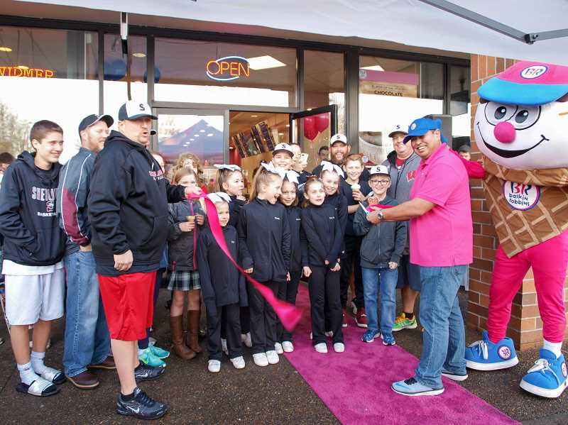 COURTESY OF TJ HAIMOTO -  Sherwoods Baskin Robbins ice cream parlor reopened to lots of fanfare including a ribbon-cutting on Feb. 4 as Terrence Haimoto and family took over as the newest owners of the business. Thats  Terrances son, David, right inside the Wally the Waffle Cone costume.