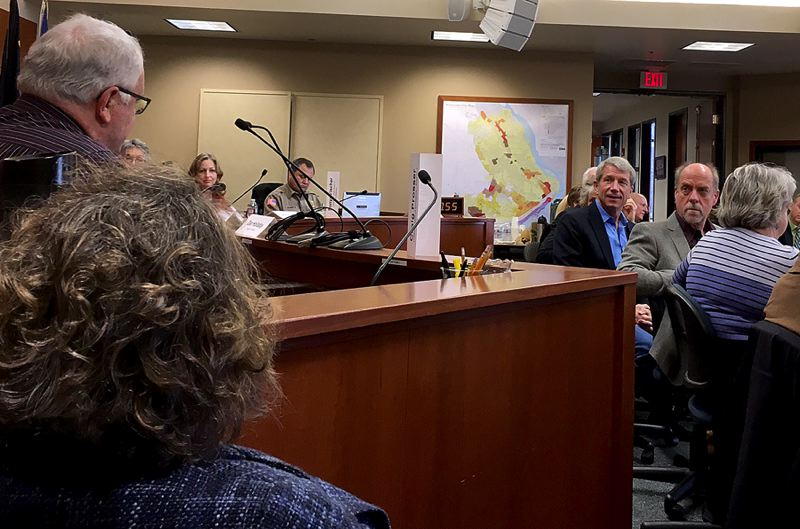 PAMPLIN MEDIA GROUP: PETER WONG - U.S. Rep. Kurt Schrader, center, turns to answer a question by TriMet board member Craig Prosser, left, at a meeting Friday, Feb. 10, with local officials at West Linn City Hall. Mayor Russ Axelrod is to the right of Schrader.