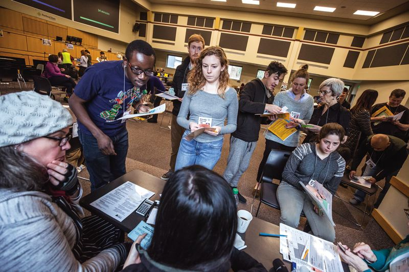 PORTLAND TRIBUNE: JONATHAN HOUSE - Participants in a poverty simulation at Portland State deal with bureaucracy at each station as they try to navigate the lives of the poor.