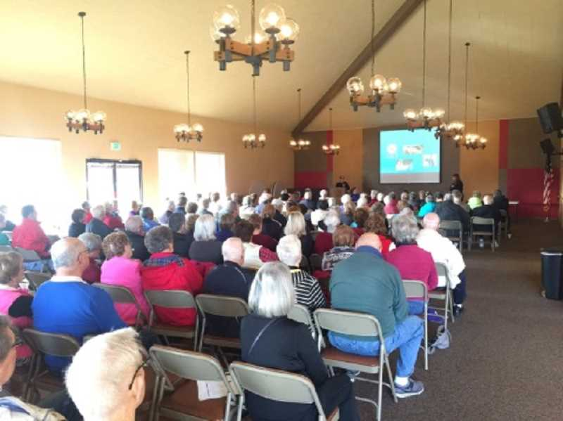 COURTESY OF TIGARD POLICE DEPARTMENT - The Summerfield Clubhouse ballroom was full of residents attending a Feb. 10 presentation on avoiding becoming a scam victim put on by the Tigard Police Department.