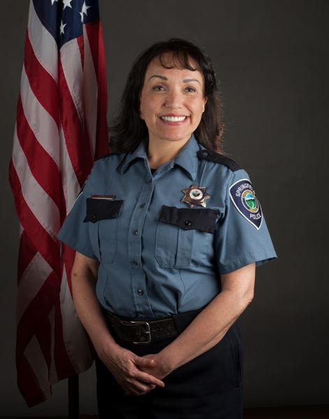 COURTESY PHOTO - Thelma Barone's job as community liaison for the Springfield Police Department included acting as a Spanish interpreter for people talking with the police chief.
