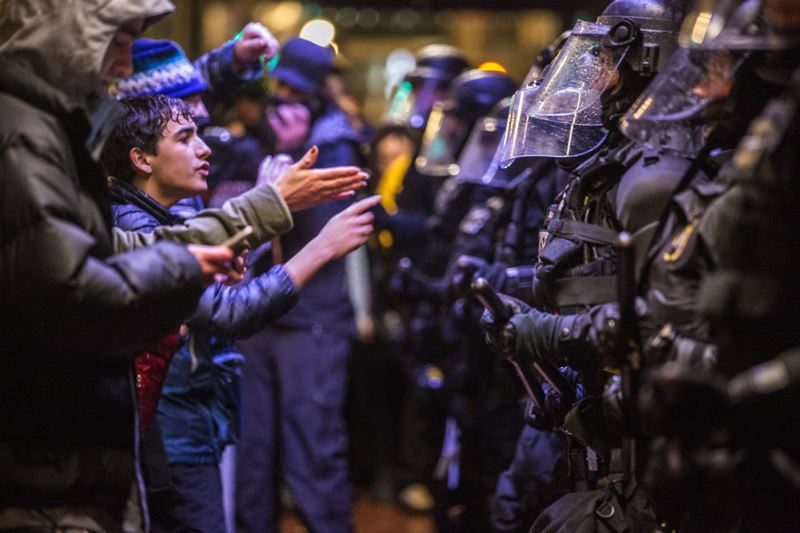 TRIBUNE FILE PHOTO: JONATHAN HOUSE - Police and protesters square off in downtown Portland on Inauguration Day, Jan. 20.
