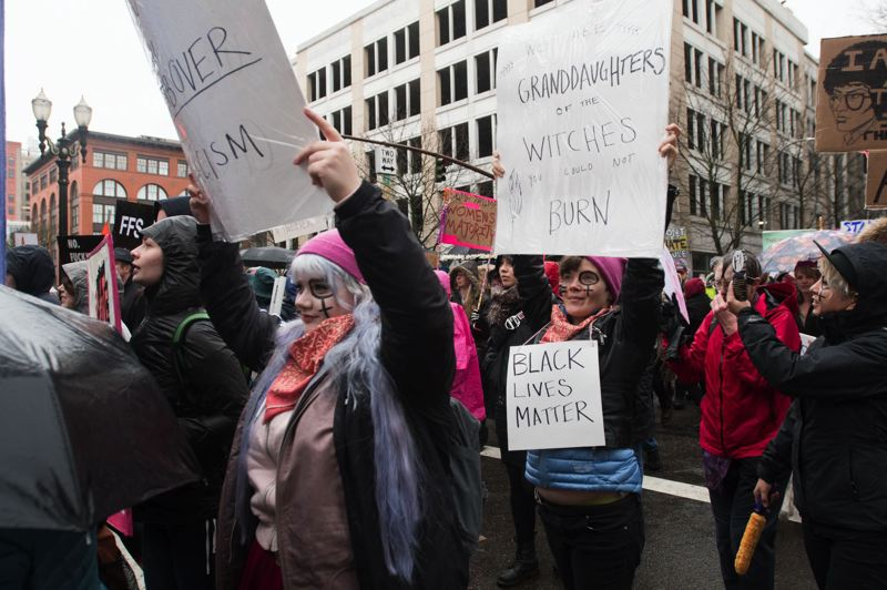 TRIBUNE FILE PHOTO - Protesters make their way along Southwest Fourth Avenue in downtown Portland as part of the Portland Women's March on Jan. 21.