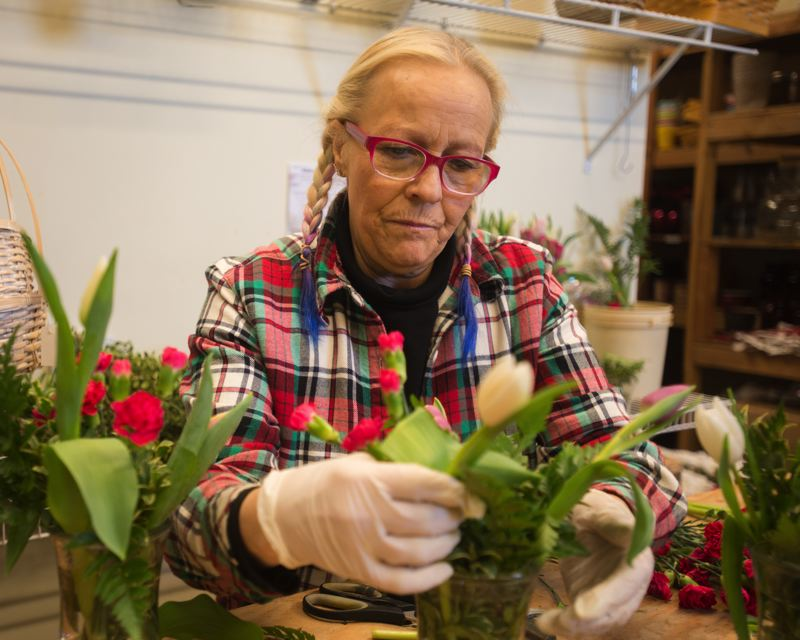 OUTLOOK PHOTO: JOSH KULLA - Nancy's Flowers employee Nila Hamilton pieces together a Valentine's Day bouquet Monday morning during one of the shop's busiest days of the  year.