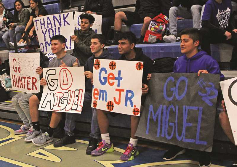 INDEPENDENT PHOTO: JULIA COMNES - Project Unify aims to create inclusive school environments, as illustrated by the encouraging signs in the student section.