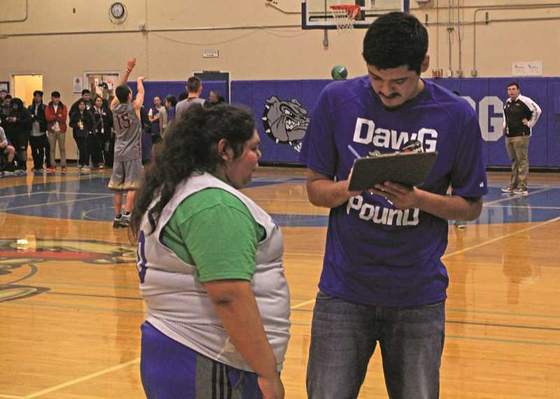 INDEPENDENT PHOTO: JULIA COMNES - Coach Omar Perez (right), a senior at WAAST, has been involved with Project Unify since he was a freshman.