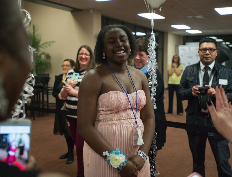 OUTLOOK PHOTO: JOSH KULLA - Chardane, sporting her lovely wrist corsage, struts her stuff on the red carpet at the prom at Mountainview Christian Church.