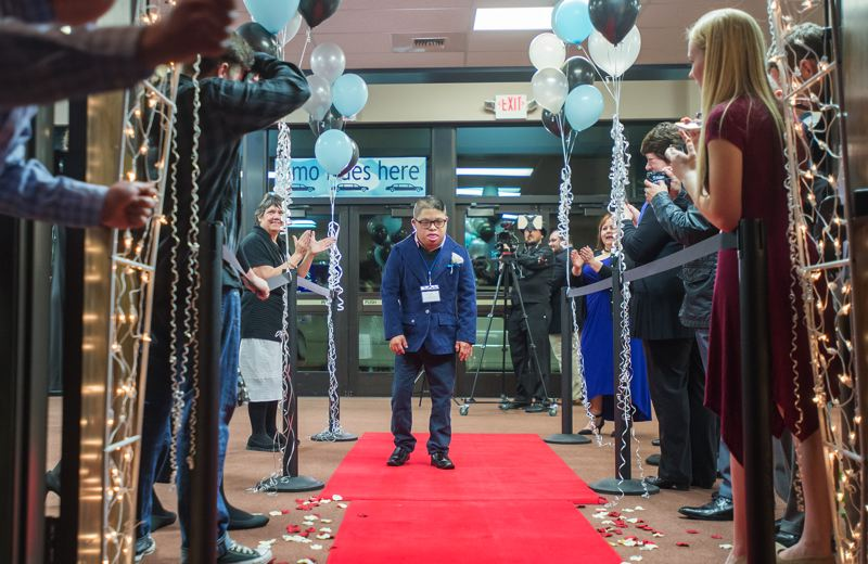 OUTLOOK PHOTO: JOSH KULLA - A Night to Shine prom guest enjoys his moment on the red carpet. He was joined by more than 75,000 party goers at 375 proms around the world.