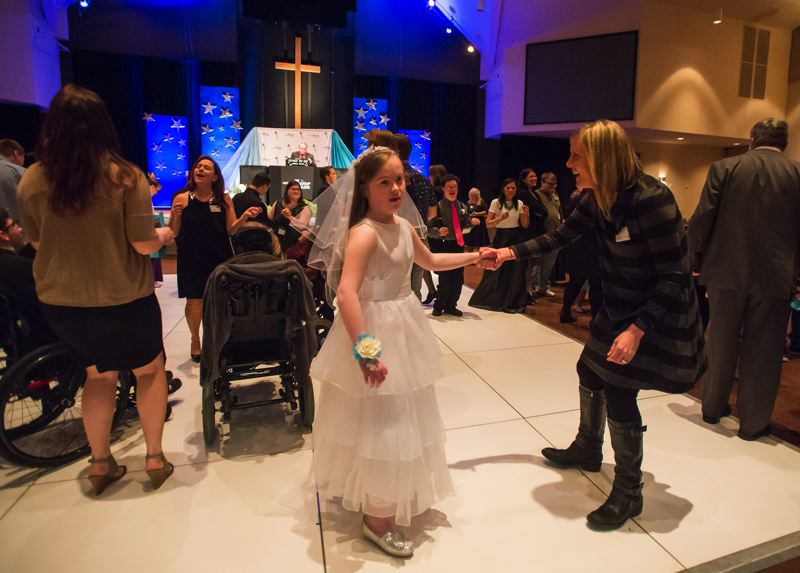 OUTLOOK PHOTO: JOSH KULLA - Jamie wears a beautiful white gown and sparkly shoes to her first prom, hosted by Mountainview Christian Church.